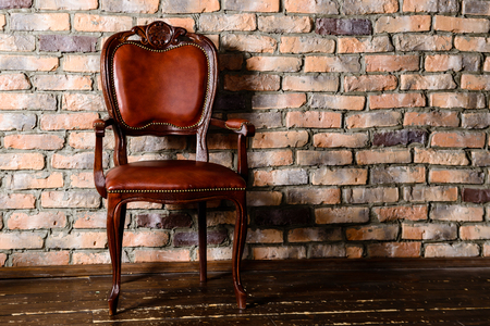 Brown leather chair in the room