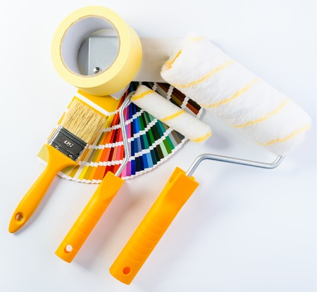 Paintbrush, paint rollers, adhesive tape and colorful paint samp 写真素材