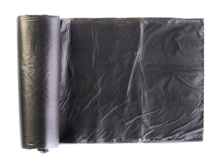Black plastic polyethylene garbage bag rolled and isolated on wh Stock Photo
