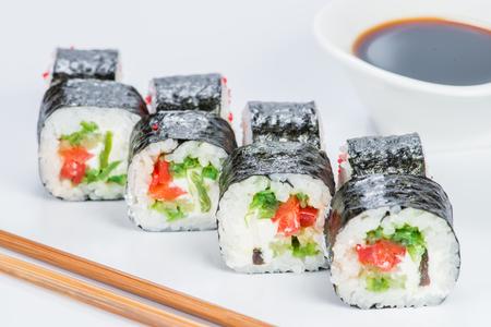Tasty fresh Sake Avocado Maki sushi with rice, avocado, tobiko a
