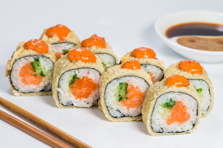 Japanese cuisine. Appetizing set of maki sushi rolls with rice, Stockfoto