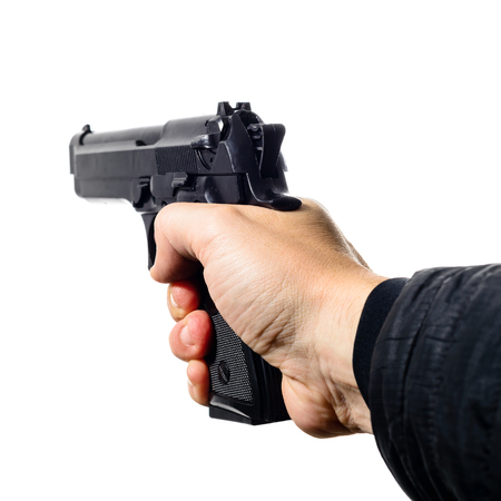 mans hand holding a black pistol gun, isolated on white, close-