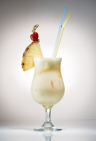 Cocktail pina colada with a piece of pineapple