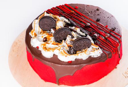 Appetizing sweet dessert. Dark glaze cake with cookies and jam o