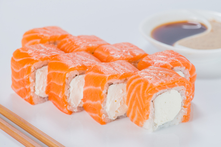 Delicious Philadelphia sushi rolls with rice, cream cheese and s Stock Photo - 105053881