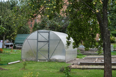 Garden greenhouse outdoors greenhouse for growing tomatoes in the country