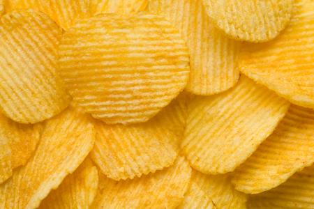 food background potato chips rippled macro shallow dof Stock Photo