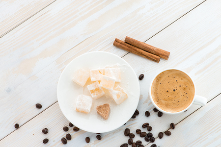 breakfast coffee and dessert oriental sweets Turkish delight flat lay of a white wooden table