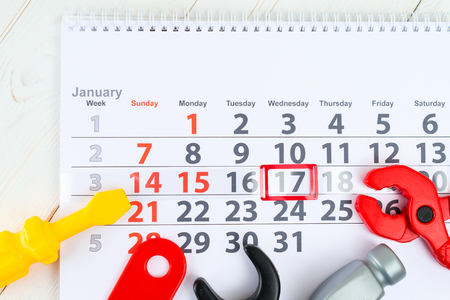 January 17th. Day 17 of month on white calendar and toy. Day of childrens inventions