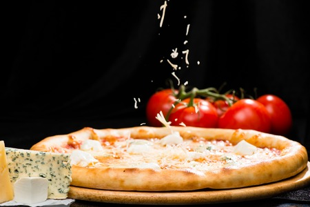 selective focus on appetizing Italian cheese pizza with mozzarel Stock Photo