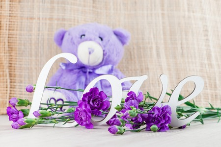 Valentines day concept with toy bear, letters love and flower Stock Photo
