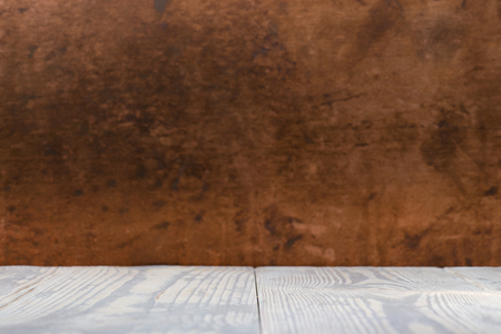 Empty wooden table space platform and blurred copper background for product display montage