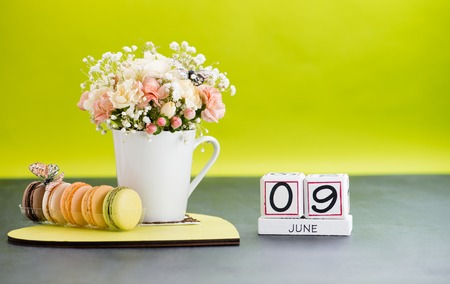 Calendar 9 June Still Life with Flowers and gifts. Friendship Day, World Accreditation Day, International Archives Day Stock Photo