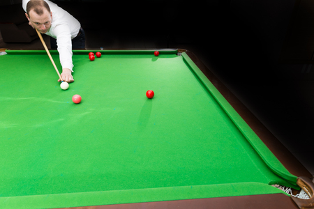 Male athlete game Billiards snooker, shallow dof Stock Photo