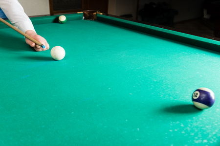Billiards pool game, athlete with cue