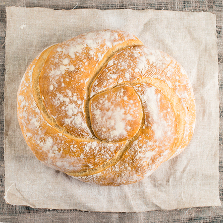baked good on a light textile background, flat lay, capital bun Stock Photo