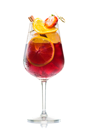 alcoholic cocktail Jager bomb with cinnamon sticks, strawberry and grapefruit in wine glass isolated on white background