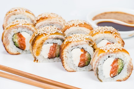 Japanese cuisine. Appetizing sushi rolls with rice, cream cheese Stock Photo