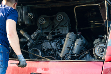 engine maintenance, inspection of engine of the bus before the trip