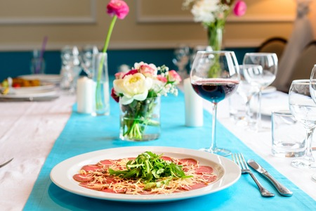 tasty beef carpaccio on the table in the restaurant, romantic dinner