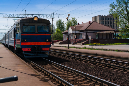 old electric train approaching in the station, symbol of railway travelling Stock Photo