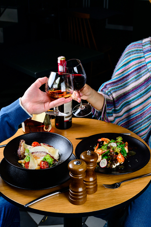 Unidentified couple enjoying time during romantic dinner in the restaurant