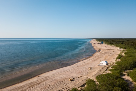 Aerial view of coast in Lithuania Baltic cold sea on a hot sunny day beach