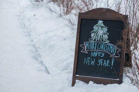 banner of merry christmas and happy new year on a snow Stock Photo