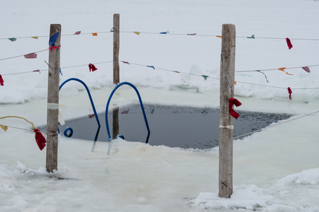 ice hole in the ice is ready for Epiphany bathing, Orthodox tradition