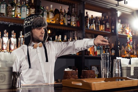 Cocktail bars, bartender making a cocktail February 6th Bartenders Day Minsk, toned, Belarus, 2019