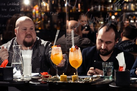 Cocktail bars, cheerful company of friends celebrates February 6th Bartenders Day Minsk, toned, Belarus, 2019 Editorial