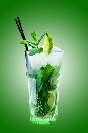 classic alcoholic mojito cocktail on a green background studio