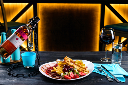 appetizer and wine for a romantic evening in a restaurant, copy space place for text, designers mock-up