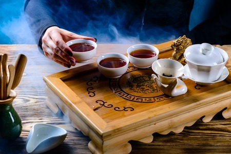 tea ceremony, the girl pours tea puer in bowls, hookah smoke