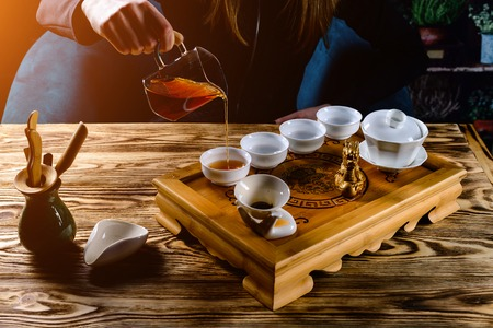 tea ceremony, the girl pours tea puer in bowls Banco de Imagens