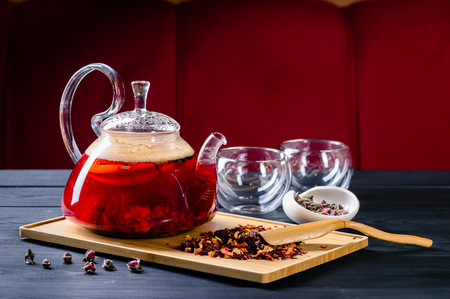 red tea in a glass teapot, tea ceremony copy space