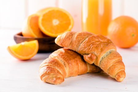 fresh croissant for breakfast with fresh orange juice, breakfast concept
