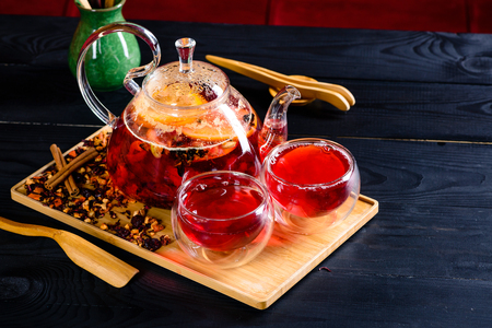 red tea in a glass teapot, tea ceremony Banco de Imagens