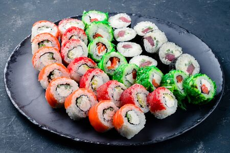 sushi set on a black table, Traditional Japanese food - sushi, rolls on a dark background. Top view Stock Photo