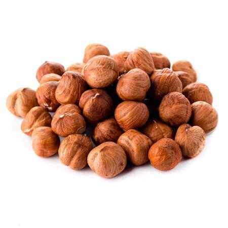 Unshelled hazel nuts isolated, food background of hazelnut nut on white background Stock Photo