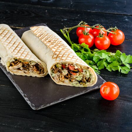 turkish shawarma with chicken and lamb in pita bread, classic tortilla wrap with grilled chicken