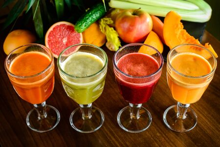 a set of cool fresh squeezed juices or cocktails in a glasses made from orange, kiwi, lemon, grapes, pomegranate