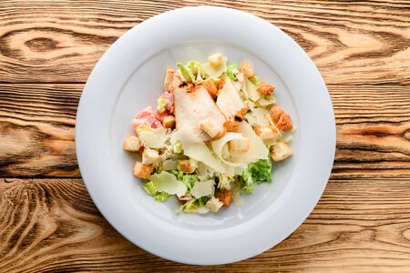 Caesar salad made of fresh vegetables with chicken top view, flat lay