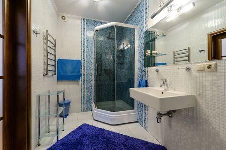 Modern twin bathroom interior with sinks, toilet and shower, Restroom with beige tile decoration and flooring