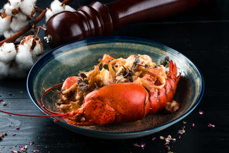 a luxury dish of lobster roasted and decorated with many items of vegetable Stok Fotoğraf