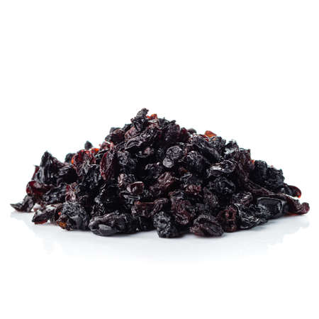 Pile of healthy raisins isolated, dried raisins grapes on white background. Reklamní fotografie