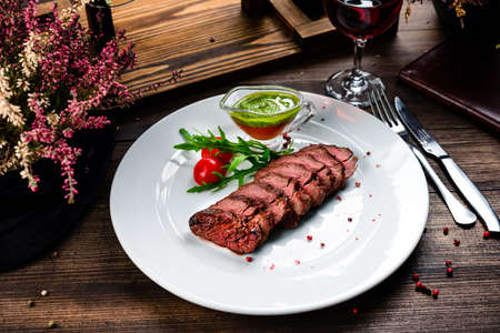 Homemade Cooked Skirt Steak with Chimichurri Sauce and Spices, Traditional barbecue skirt steak sliced Reklamní fotografie
