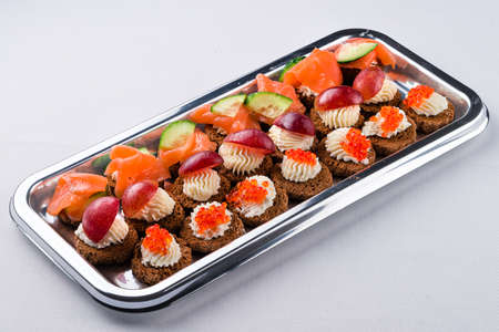 mini canapes with smoked salmon on platter for a party. mini canapes with smoked salmon Reklamní fotografie