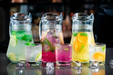 Lemonade set. Lemonade, mojito and orange lemonade. Iced summer drink in mason jar with ingredients. set of summer lemonades
