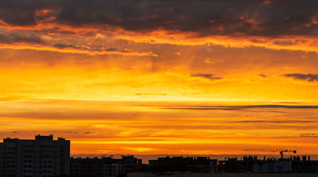 Sunset over city scape, sunrise sky landscape with line row of city buildings silhouette. Pamoramic wide banner Reklamní fotografie